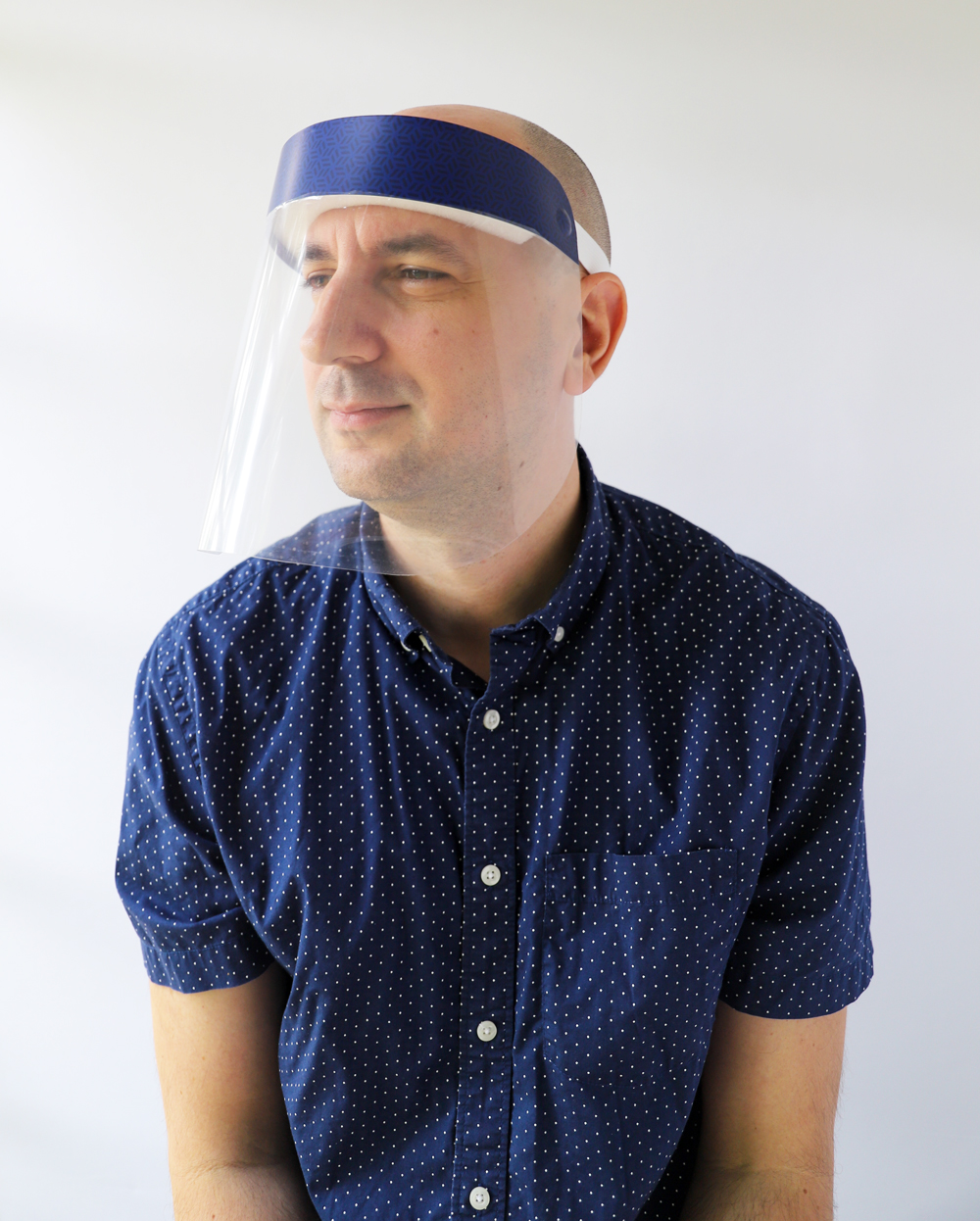 Men's Blue Hexagons Plastic Face Shield protects your eyes, mouth, and nose with style and fun